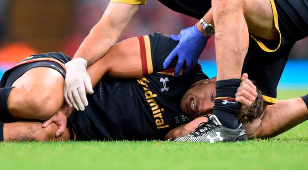 Wales' Rhys Webb lies on the ground injured during the World Cup Warm up match at the Millennium Stadium, Cardiff