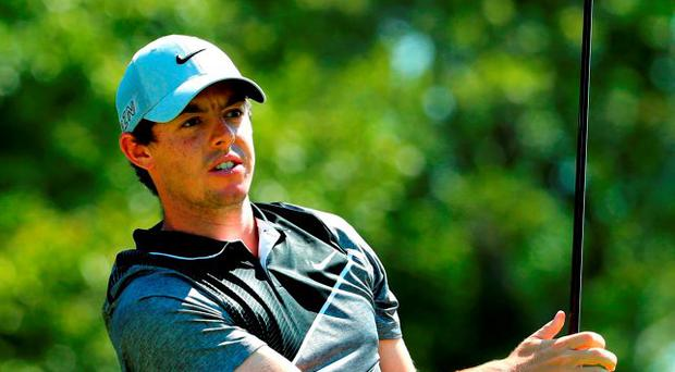 Rory McIlroy of Northern Ireland hits a tee shot on the 17th hole during the final round of the Deutsche Bank Championship