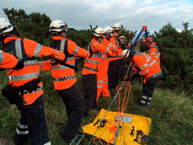 Members of the Irish Coastugar used a rope haul system to recover a walker stranded on 50 metre high cliffs in Howth this evening Pic: Irish Coastguard