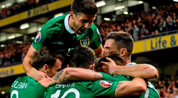 Jon Walters, hidden, Republic of Ireland, is congratulated by team-mates after scoring his side's first goal. UEFA EURO 2016 Championship Qualifier, Group D, Republic of Ireland v Georgia, Aviva Stadium, Lansdowne Road, Dublin. Picture credit: Cody Glenn / SPORTSFILE