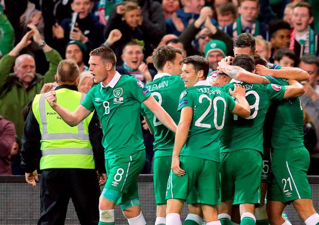 Republic of Ireland's players celebrate their first goal during the Euro 2016 qualifying group D football match between Republic of Ireland and Georgia