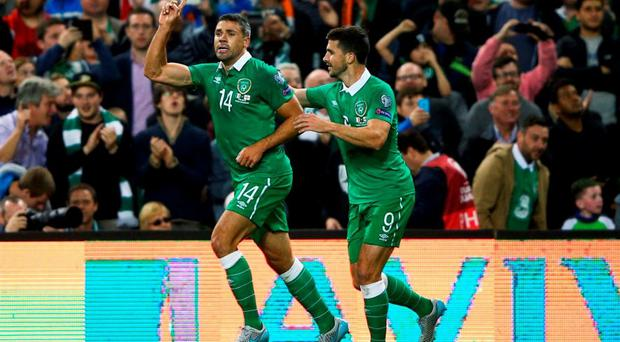 Jonathan Walters of the Republic of Ireland (14) celebrates with Shane Long (9) as he scores their first goal during the UEFA EURO 2016 Group D qualifying match between Republic of Ireland and Georgia