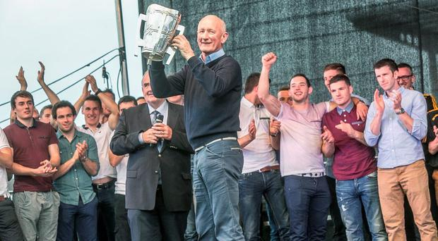Brian Cody brings the Liam McCarthy Cup onstage during the homecoming for the Kilkenny team