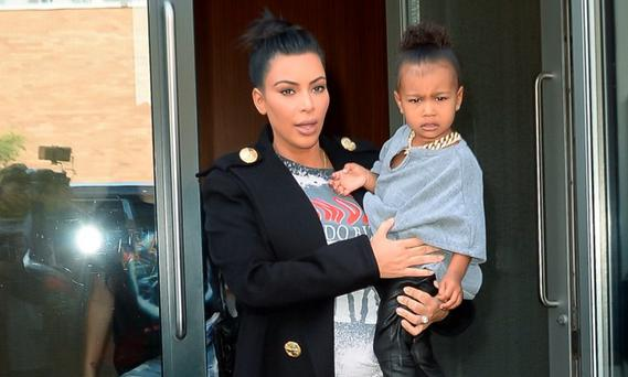Kim Kardashian and North West are seen walking in Soho on September 7, 2015 in New York City. (Photo by Raymond Hall/GC Images)
