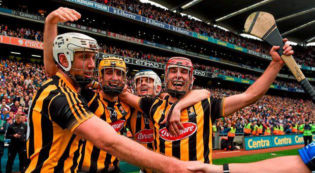 Kilkenny players, from left, Michael Fennelly, Colin Fennelly, TJ Reid, and Cillian Buckley, celebrate after the final whistle in last year's final