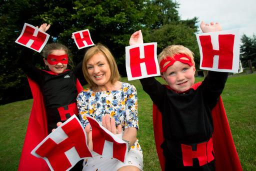 Kate (6) and Cian McNamara (2) help broadcaster Mary Kennedy launch this year's Hidden Heroes Awards. Photo: Naoise Culhane