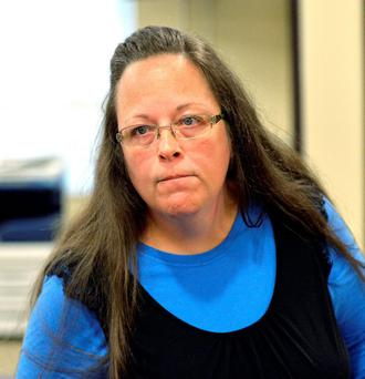 Rowan County Clerk Kim Davis listens to a customer following her office's refusal to issue marriage licenses at the Rowan County Courthouse in Morehead, Ky., Tuesday, Sept. 1, 2015. AP Photo/Timothy D. Easley)