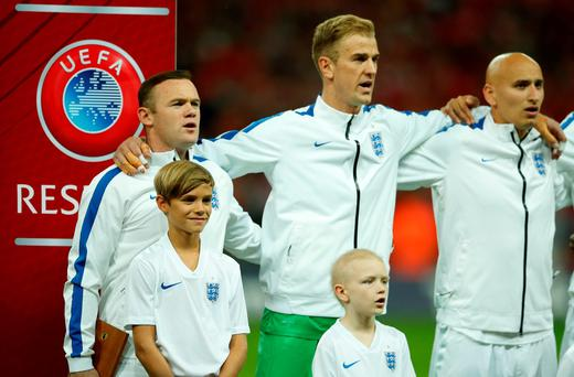 England's Wayne Rooney with David Beckham's son Romeo before the match Action Images via Reuters / John Sibley