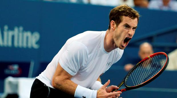 Andy Murray reacts after losing a point to Kevin Anderson during his fourth round exit at the US Open