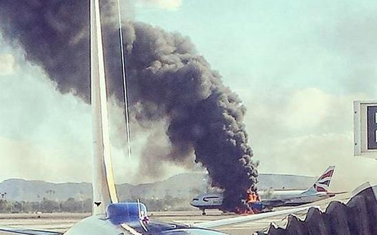 A British Airways plane can be seen in flame at LAS airport Las Vegas Photo: Twitter @banjo