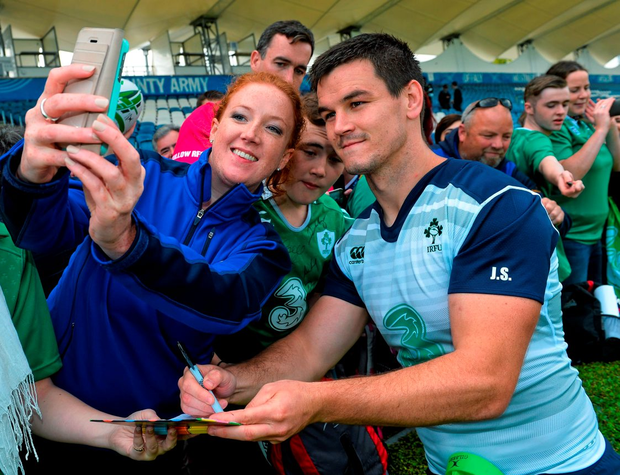 Ireland's Jonathon Sexton takes a 'selfie' with a supporter following squad training. RDS, Ballsbridge, Dublin