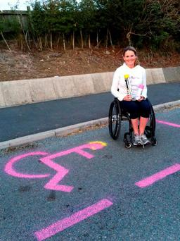 Claire Lomas of her in a disabled parking bay she painted herself outside her daughter's school Credit: Claire Lomas/PA Wire