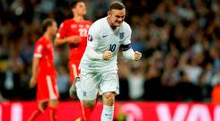 England's Wayne Rooney celebrates scoring his side's second goal of the game and his 50th international goal during the UEFA European Qualifying match at Wembley