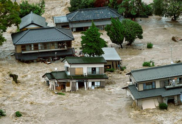 People inside houses wait to be rescued as the houses are submerged in water flooded from a river in Joso, Ibaraki prefecture