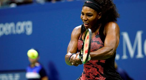 Serena Williams returns a shot to Venus Williams during a quarterfinal match at the U.S. Open tennis tournament, Tuesday, Sept. 8, 2015, in New York. (AP Photo/Julio Cortez)