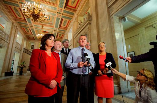 Sinn Fein's Conor Murphy (centre) speaking to the media in the great hall of Stormont in Belfast as pressure mounts on the smaller parties in the Northern Ireland Executive to adjourn the Assembly as a means to avert the suspension or collapse of powersharing. Niall Carson/PA Wire