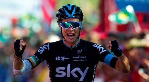 Sky's Irish cyclist Nicolas Roche celebrates as he crosses the finish line during the 18th stage of the 2015 Vuelta Espana cycling tour, a 204 km route between Roa and Riaza on September 10, 2015. AFP PHOTO / JAIME REINAJAIME REINA/AFP/Getty Images