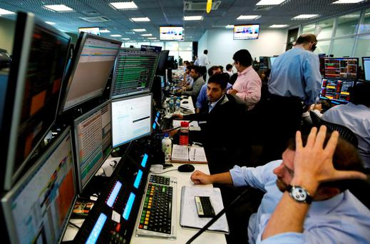 Traders work at XP Investimentos brokerage in Sao Paulo, Brazil. Photo: Reuters