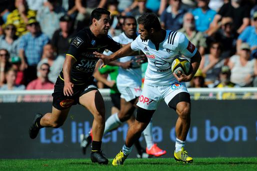 Brive's Gaetan Germain is tackled by La Rochelle's Australian winger Malietoa Hingano on September 5, 2015 at the Marcel Deflandre stadium in La Rochelle (XAVIER LEOTY/AFP/Getty Images)