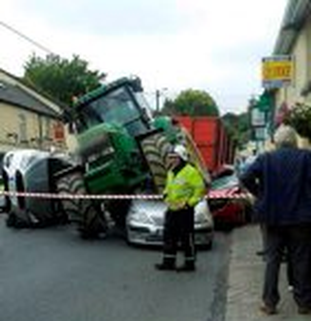 The scene in Ardfinnan, Co Tipperary, where a tractor crashed in to a shop and three cars. No one was injured. PIC: Nigel Carrigan ?@CarriganNigel