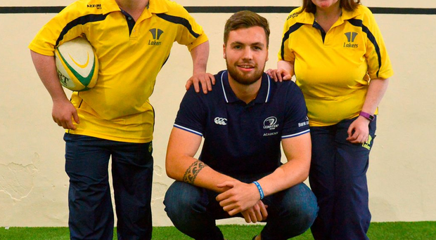 Leinster Rugby Academy's Harrison Brewer with Bray Lakers' Matthew Davis and Marian O'Rourke at the opening of the newly renovated Brady Centre, the home of the Lakers Social & Recreational Club PIARAS Ó MÍDHEACH / SPORTSFILE