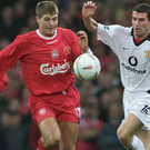 Liverpool's Steven Gerrard during one of his many tussles with Manchester United midfielder Roy Keane