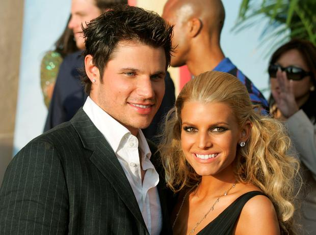 Singers Jessica Simpson (R) and Nick Lachey arrive to the 2005 MTV Movie Awards at the Shrine Auditorium June 4, 2005 in Los Angeles, California. The 14th annual award show will premiere on MTV Thursday, June 9 at 9:00PM (ET/PT). (Photo by Frazer Harrison/Getty Images)