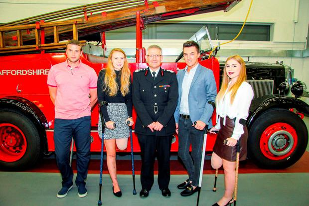 Chief Fire Officer Peter Dartford (centre) with Alton Towers roller-coaster crash victims (left to right) Daniel Thorpe, Leah Washington, Joe Pugh and Victoria Balch, who have praised their
