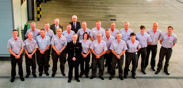 Chief Fire Officer Peter Dartford (centre) with firefighters involved in the rescue operation following the Alton Towers roller-coaster crash Credit: Staffordshire Fire and Rescue Service/PA Wire