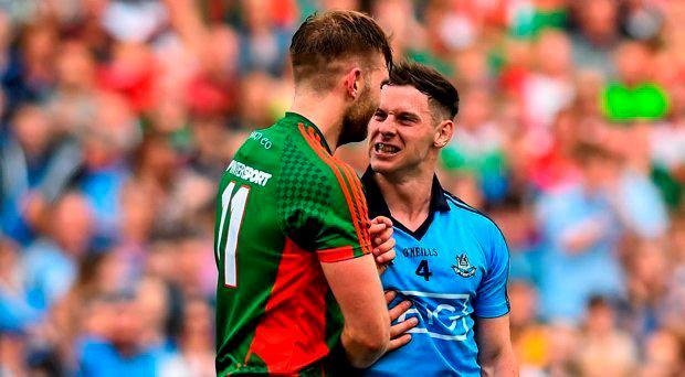 Philly McMahon, Dublin, tussles with Aidan O'Shea, Mayo