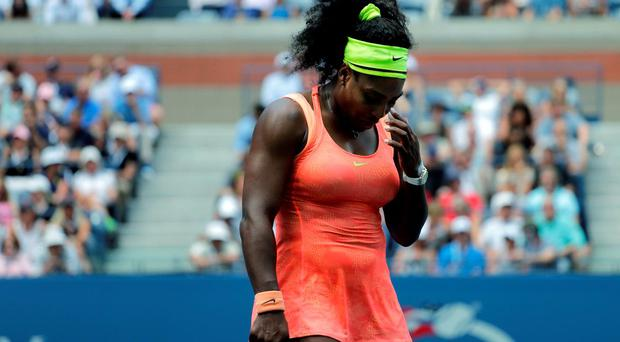 Serena Williams reacts after losing a point to Roberta Vinci, of Italy, during a semifinal match at the U.S. Open tennis tournament, Friday, Sept. 11, 2015, in New York. (AP Photo/Bill Kostroun)