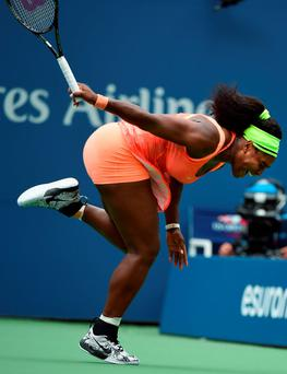 Serena Williams stumbles during her semi-final defeat at the US Open last night
