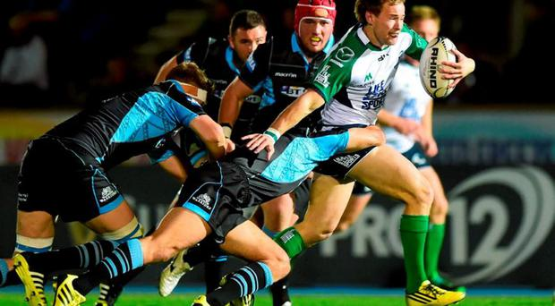 Kieran Marmion, Connacht, is tackled by Mike Blair, Glasgow Warriors. Guinness PRO12, Round 2, Glasgow Warriors v Connacht, Scotstoun Stadium, Glasgow, Scotland. Picture credit: Paul Devlin / SPORTSFILE