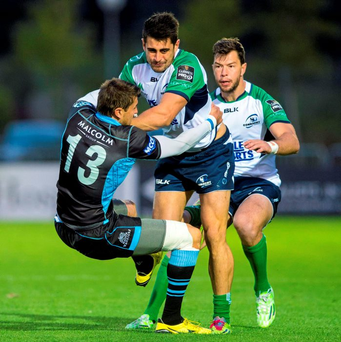 Tiernan O'Halloran, Connacht, is tackled by Peter Murchie, Glasgow Warriors