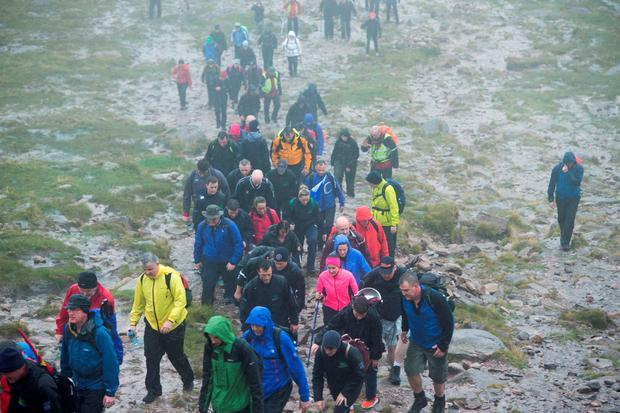 Climbers make their way up Carrauntoohill