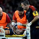 Leigh Halfpenny leaves the field injured against Itay. Without one of their talismans, the Welsh look vulnerable in the Group of Death