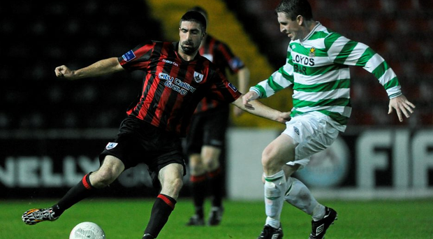 Kevin O'Connor, Longford Town, in action against Darren Dunne, Sheriff YC