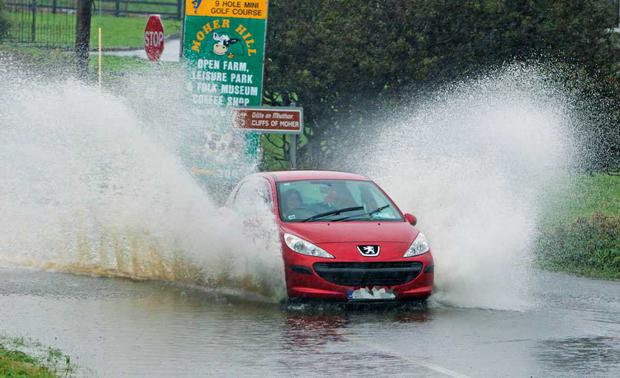 A day of heavy rain left many roads in Co Clare flooded including this section of the Lahinch to Doolin route near the Cliffs of Moher. Unsuspecting motorists had to drive through floods in several areas. Photo Press 22