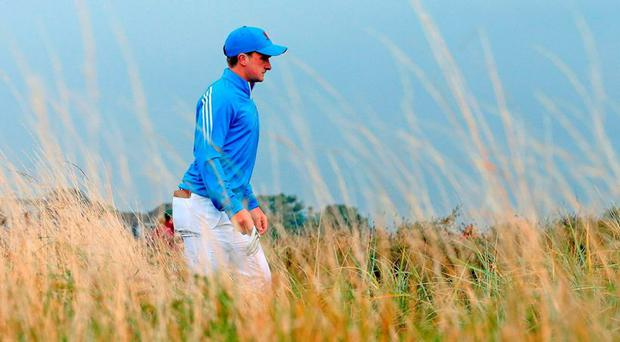 Paul Dunne from Great Britain and Ireland walks the 5th Fairway during day one of the Walker Cup at Royal Lytham & St Annes Golf Club