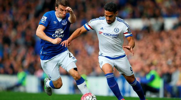 Radamel Falcao is challenged by Seamus Coleman of Everton during the Barclays Premier League match between Everton and Chelsea at Goodison Park