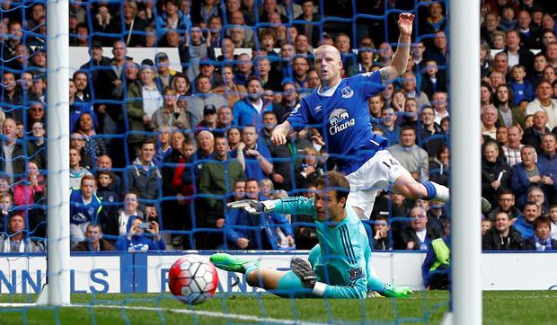 Everton's Steven Naismith scores their third goal