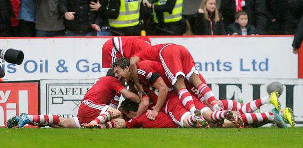 Aberdeen's Paul Quinn celebrates scoring their second goal with teammates