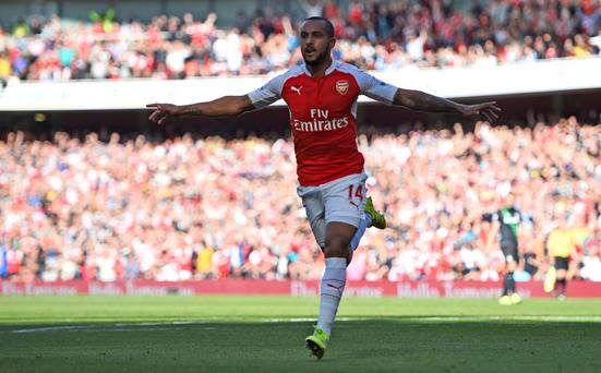 Theo Walcott celebrates after scoring against Stoke City