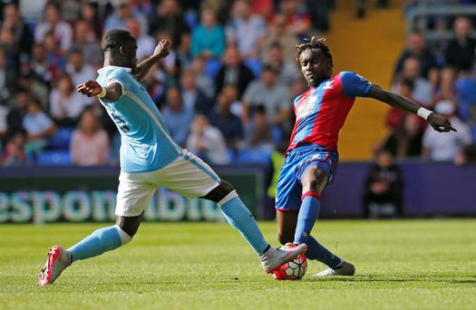 Manchester City's Bacary Sagna in action with Crystal Palace's Pape Souare