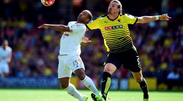 Watford's Sebastien Prodl (right) and Swansea City's Wayne Routledge battle for the ball during the Premier League match at Vicarage Road