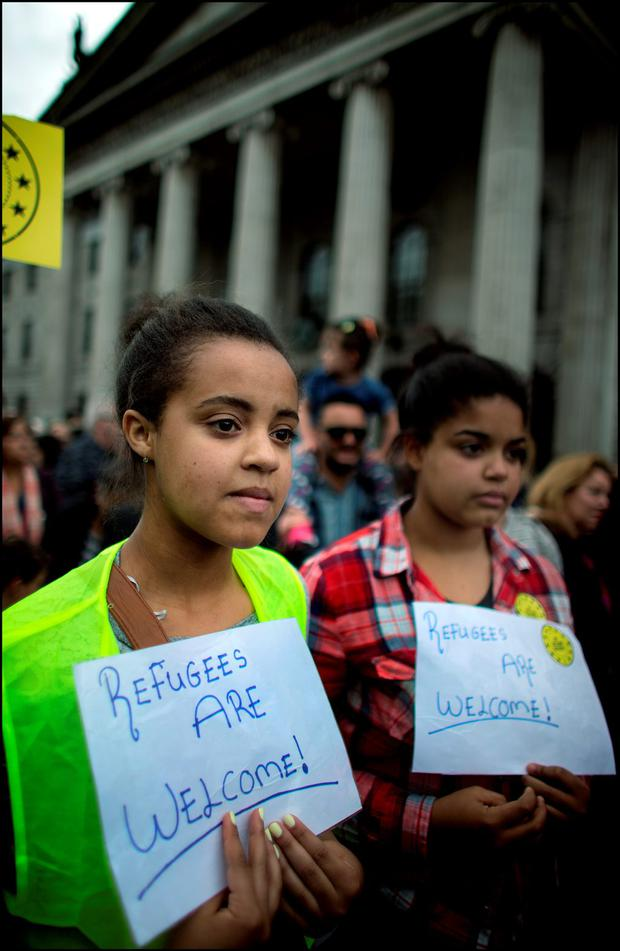 Caitriona and Fiona Omobamidele from Kildare at a welcome refugee rally on O'Connell Street Credit: David Conachy