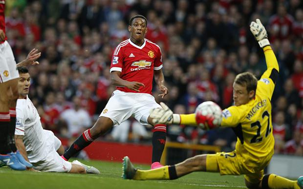Manchester United's Anthony Martial scores past Liverpool's Simon Mignolet