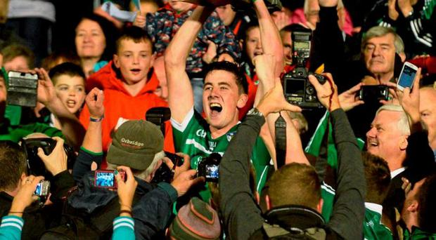 Limerick captain Diarmaid Byrnes lifts the cup after victory over Wexford