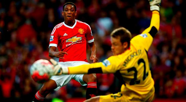 Anthony Martial of Manchester United slots one past Simon Mignolet on his debut