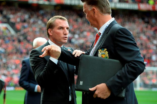 Manchester United's Louis van Gaal greets Brendan Rodgers ahead of the match